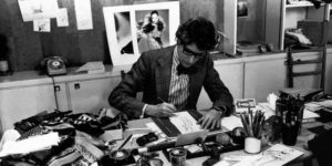 14._yves_saint_laurent_at_his_desk_in_1976_-r_fondation_pierre_bergr_-_yves_saint_laurent_paris_photo_guy_marineau